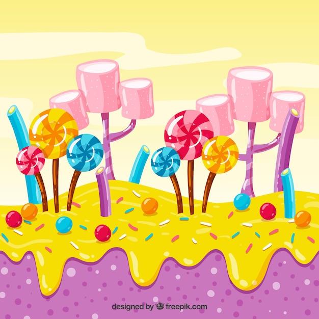 Fond de terres colorées de bonbons dans un style dessiné à la main Vecteur gratuit