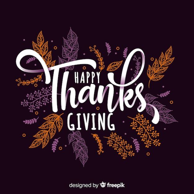 Fond de thanksgiving dessiné à la main avec les lettres de l'automne Vecteur gratuit
