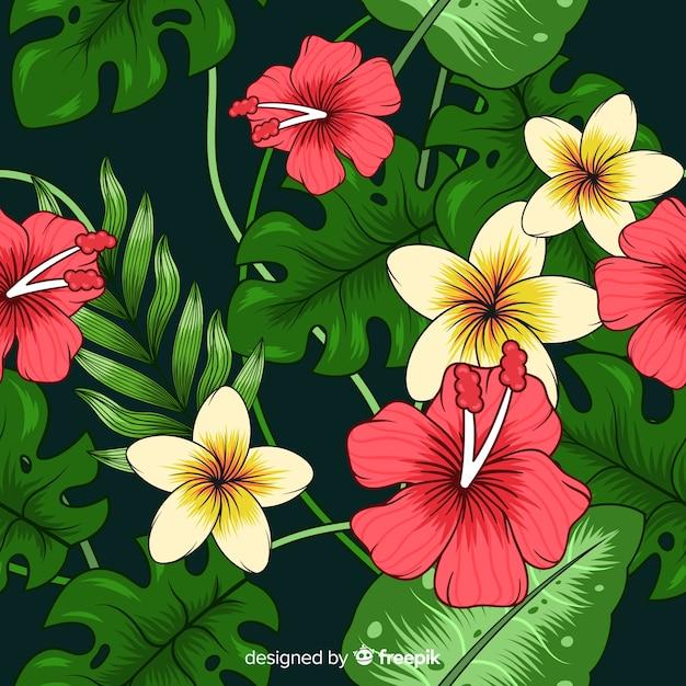Fond tropical avec des fleurs colorées Vecteur gratuit