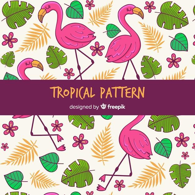 Fond tropical avec des fleurs, des feuilles et des flamants roses Vecteur gratuit