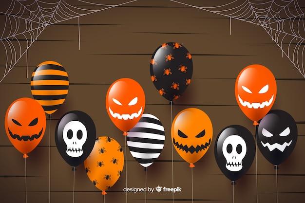 Fond de vente plat halloween avec des ballons Vecteur gratuit