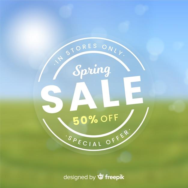 Fond de vente de printemps flou Vecteur gratuit
