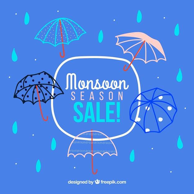 Fond de vente de saison de mousson avec des parapluies Vecteur gratuit