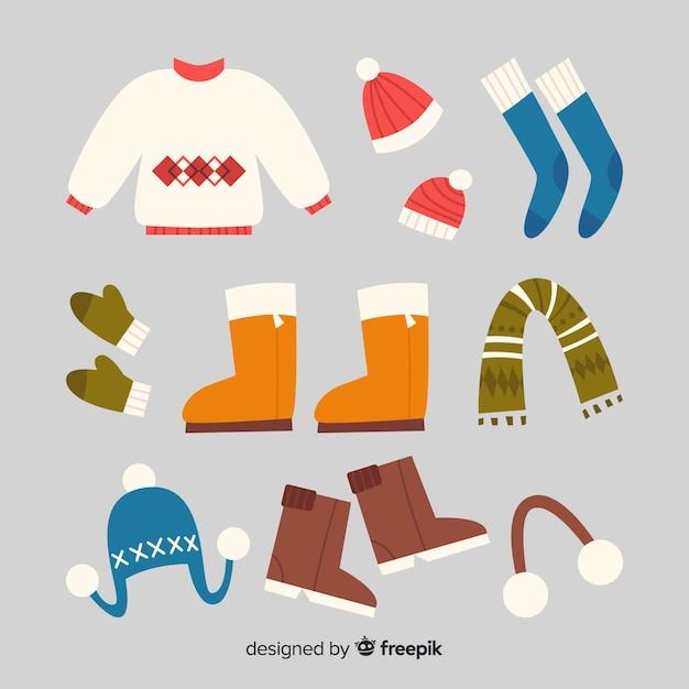 Fond de vêtements d'hiver dessinés à la main Vecteur gratuit