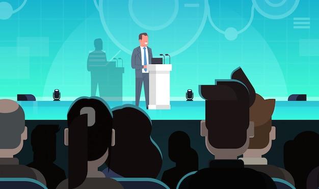 Formation en entreprise ou en coaching homme d'affaires menant une présentation devant un groupe d'hommes d'affaires Vecteur Premium