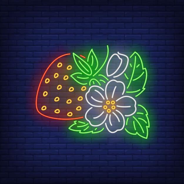 Fraise avec fleur et feuilles enseigne au néon. Vecteur gratuit