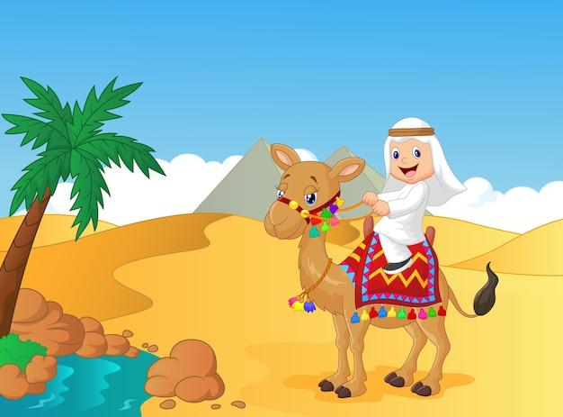 Garçon arabe à dos de chameau Vecteur Premium