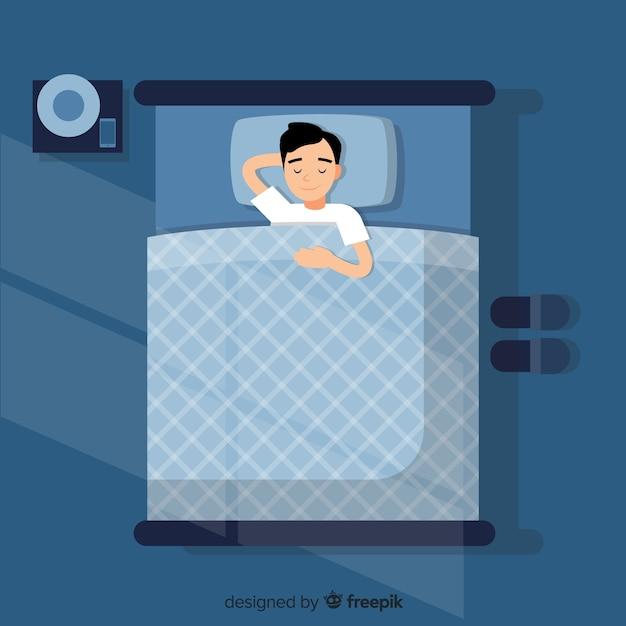 Garçon dormant dans son lit Vecteur gratuit