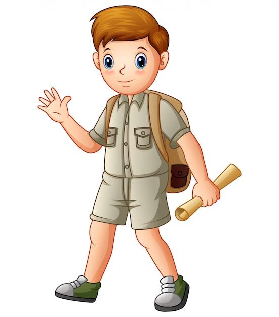 Garçon explorateur tenant une carte Vecteur Premium