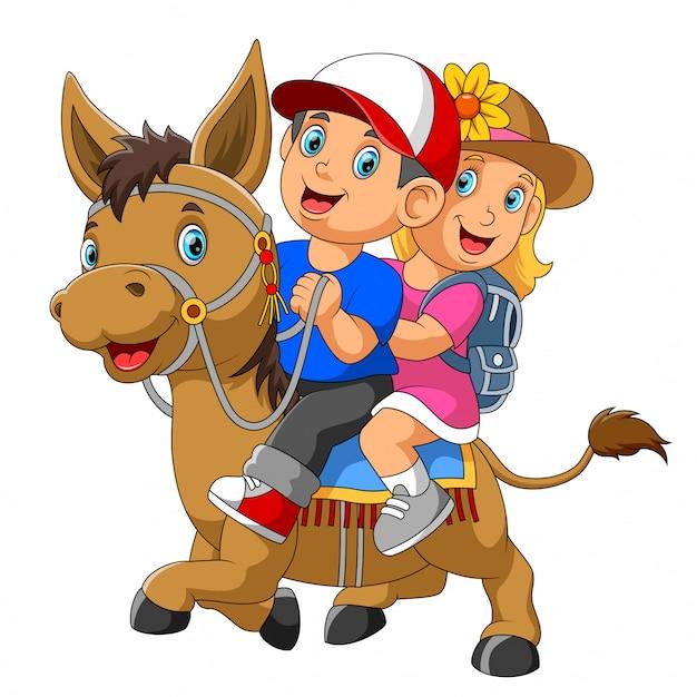 Un garçon et une fille à cheval Vecteur Premium