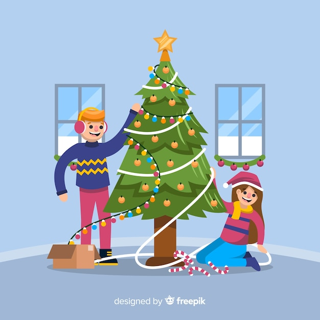Garçon et fille, décorer un arbre de noël Vecteur gratuit