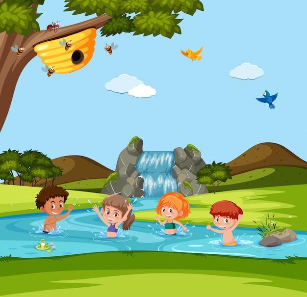 Garçon et fille jouant dans l'eau Vecteur Premium
