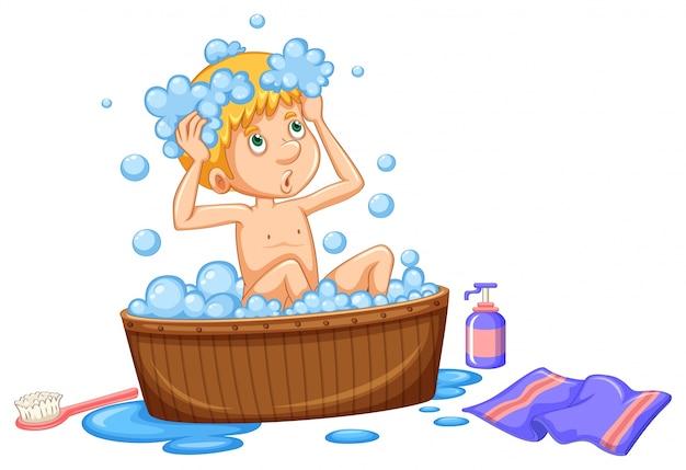 Garçon prenant un bain dans une baignoire marron Vecteur gratuit