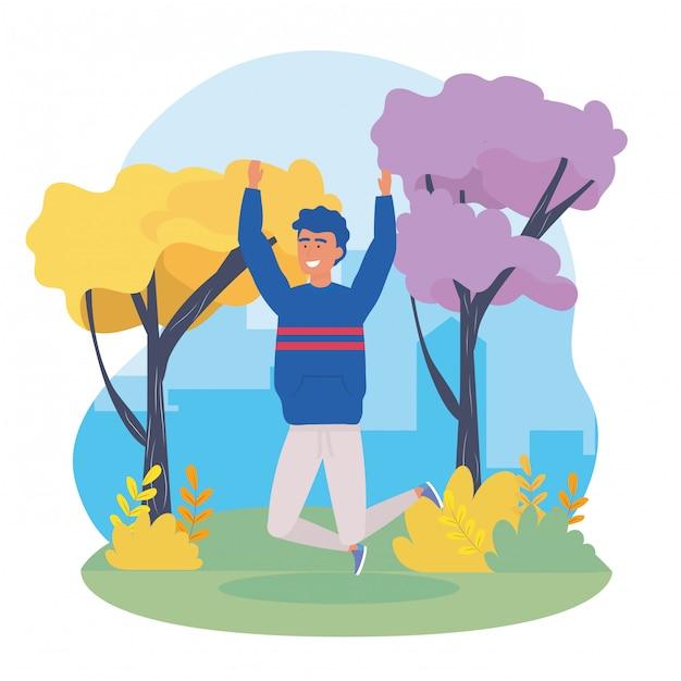 Garçon sautant avec des vêtements décontractés et des arbres Vecteur gratuit