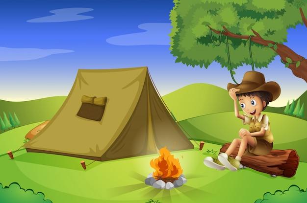 Un garçon avec une tente et un feu de camp Vecteur gratuit