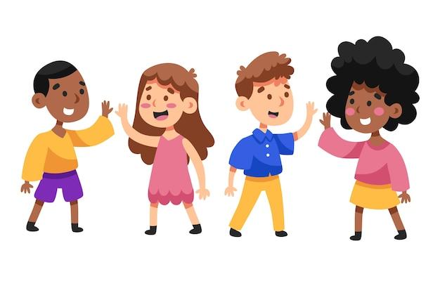 Garçons et filles donnant haut cinq Vecteur gratuit
