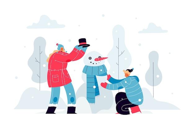 Les gens construisent un bonhomme de neige à l'extérieur Vecteur Premium