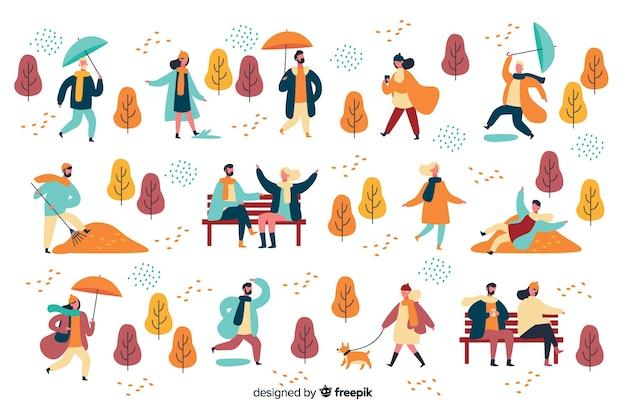 Les gens dans le parc en automne Vecteur gratuit