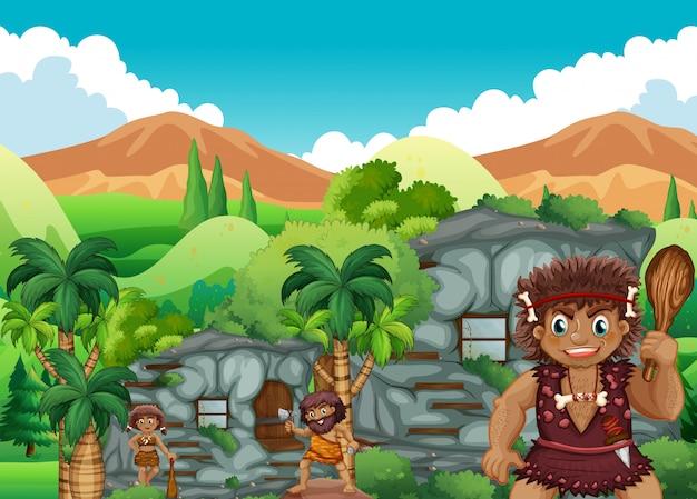 Gens de la grotte vivant ensemble dans la maison de pierre Vecteur gratuit