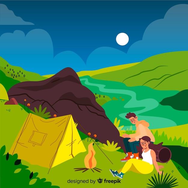 Des gens heureux campant dans la nature Vecteur gratuit