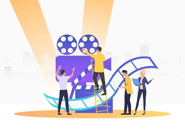 Les Gens Qui Créent Un Film Vecteur gratuit