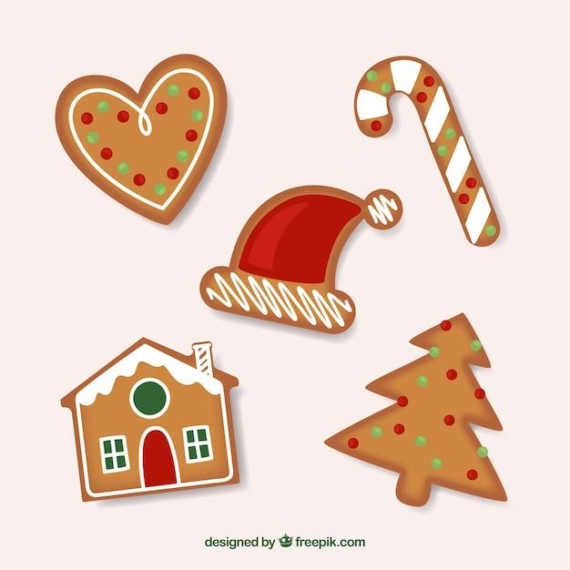 Gingerbread cookies fond des décorations de noël Vecteur gratuit