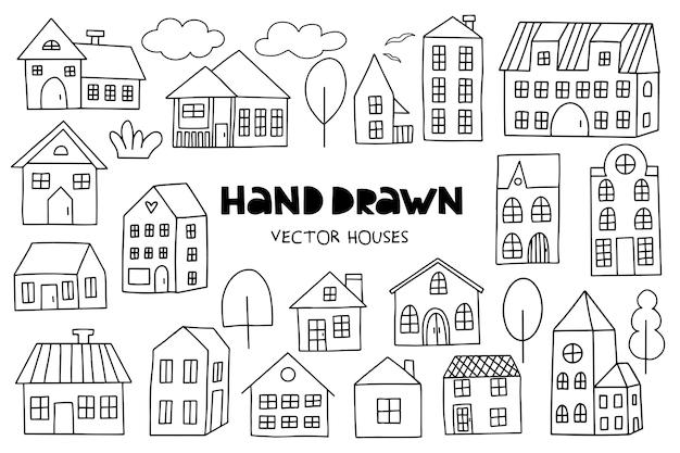 Grand ensemble de maisons dessinées à la main sur le blanc. Vecteur Premium