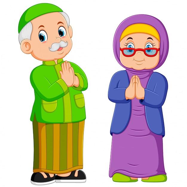 La grand-mère et le grand-père sont le pardon de l'ied mubarak Vecteur Premium
