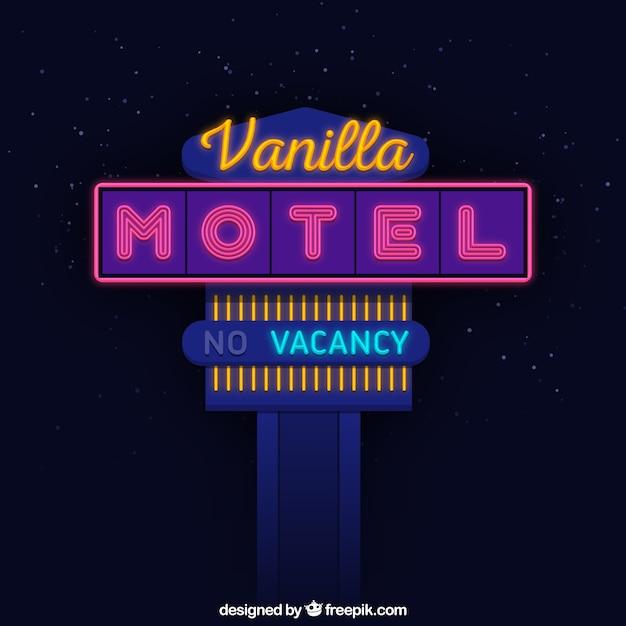 Grande enseigne au néon pour un motel Vecteur gratuit