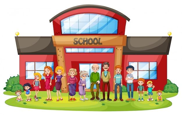 Une grande famille devant le bâtiment de l'école Vecteur gratuit