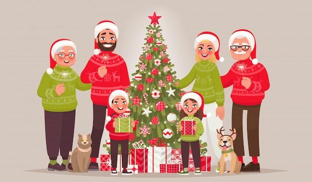 Grande Famille Joyeuse Près De L'arbre De Noël. Joyeux Noel Et Bonne Année Vecteur Premium