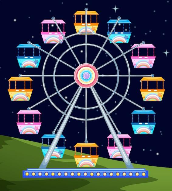 Grande roue qui tourne la nuit Vecteur gratuit