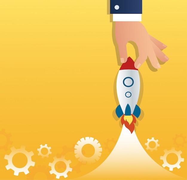 Grosse main tenant une entreprise de démarrage de fusée Vecteur Premium