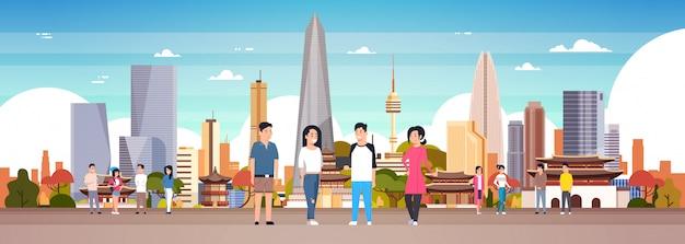 Groupe de coréens sur la ville de séoul Vecteur Premium