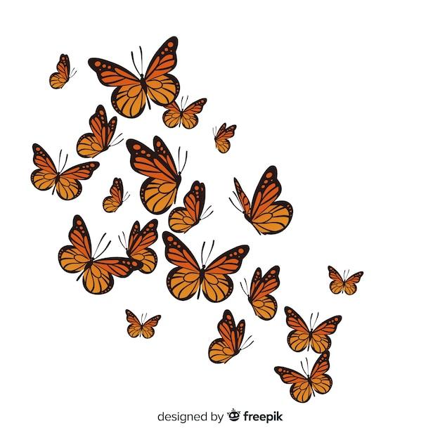 Groupe de papillons réaliste volant Vecteur gratuit