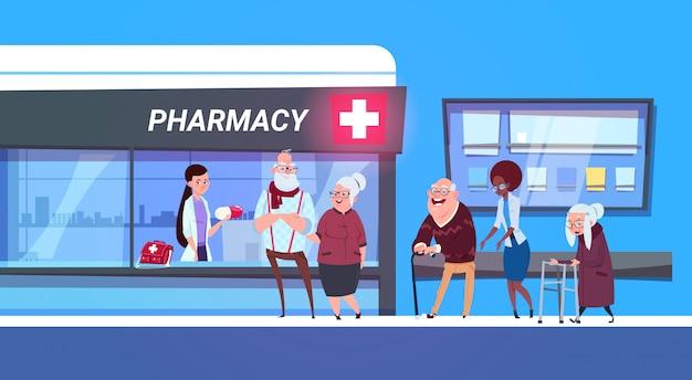 Groupe de personnes debout en ligne au magasin de pharmacie Vecteur Premium