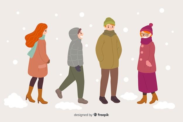 Groupe de personnes marchant dans des vêtements d'hiver Vecteur gratuit