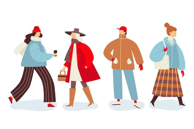 Groupe de personnes portant des vêtements d'hiver Vecteur gratuit