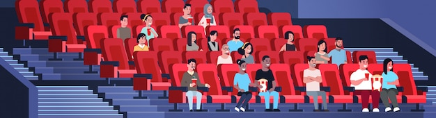 Groupe De Personnes Regardant Un Film Assis Au Cinéma Avec Pop-corn Et Cola Mix Race Hommes Femmes S'amusant De Rire à La Nouvelle Comédie Plate Pleine Longueur Horizontale Vecteur Premium