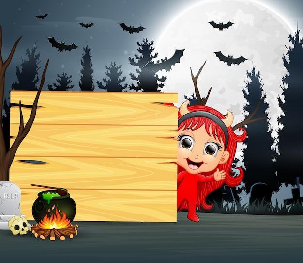 Halloween cartoon une fille en costume de diable rouge Vecteur Premium