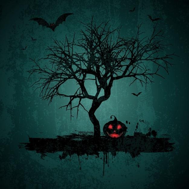 Halloween fond style grunge avec des battes cric o lanterne et arbre Vecteur gratuit