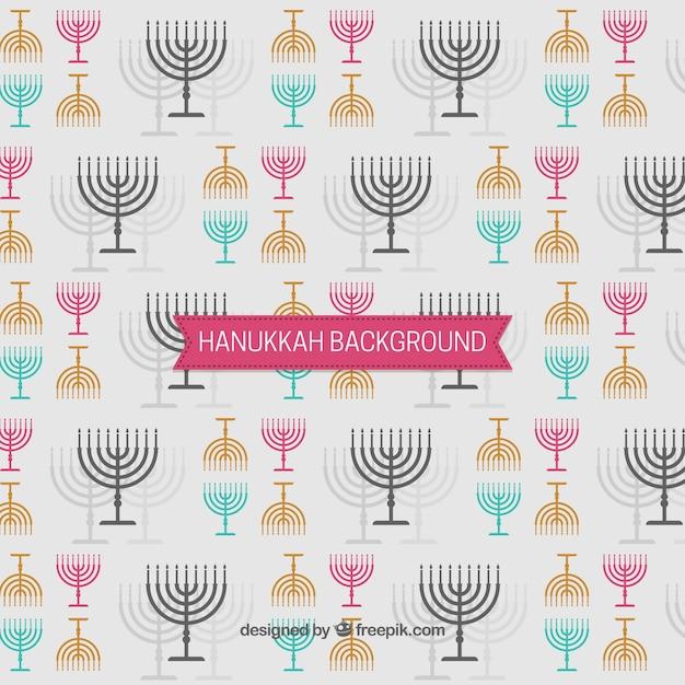 Hanukkah fond avec des candélabres en différentes couleurs Vecteur gratuit
