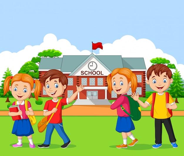 Heureux écoliers devant l'école Vecteur Premium