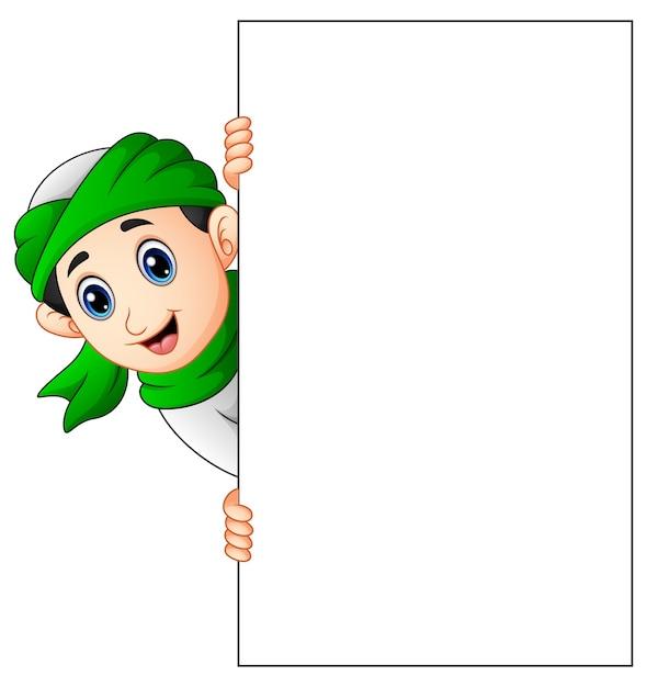 Heureux Enfant Musulman Tenant Une Pancarte Blanche Vecteur Premium