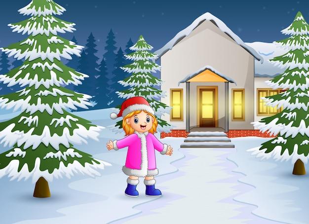 Heureux enfant qui joue devant la maison de neige Vecteur Premium