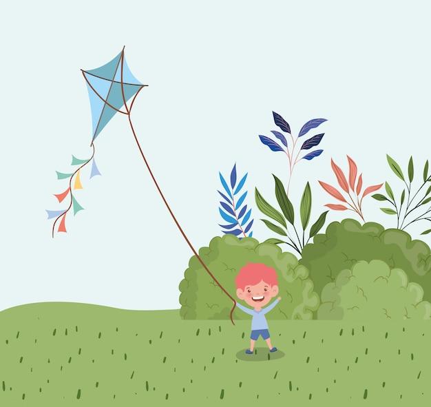 Heureux petit garçon voler le cerf-volant dans le paysage Vecteur gratuit