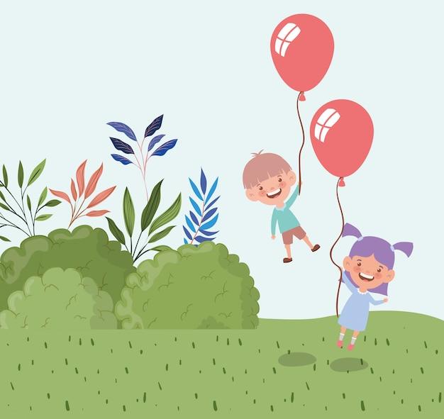 Heureux petits enfants avec des ballons à l'hélium dans le paysage de champ Vecteur gratuit