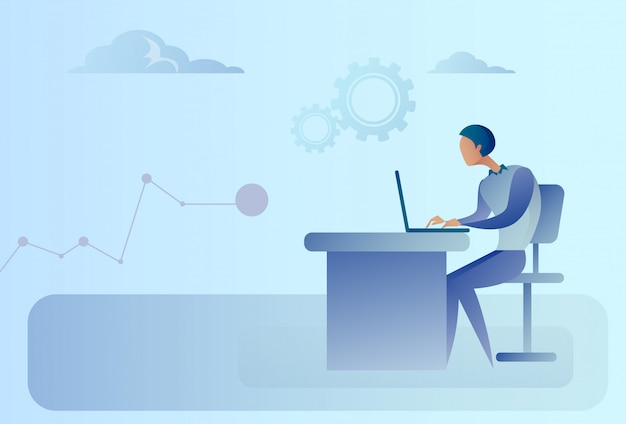 Homme d'affaires abstrait assis au bureau travaillant sur un ordinateur portable Vecteur Premium