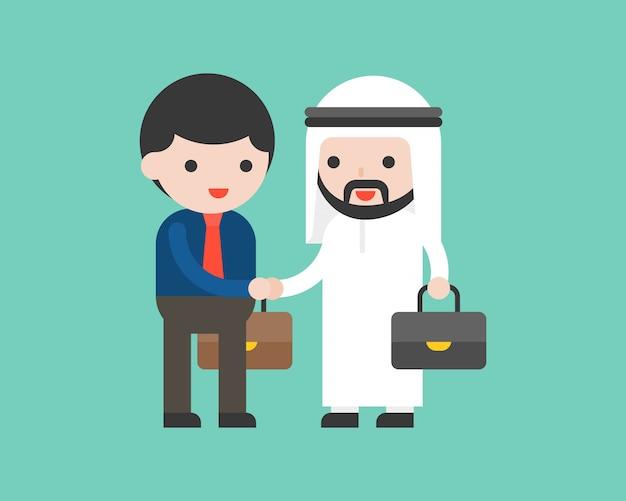 Homme d'affaires arabe mignon serrer la main Vecteur Premium
