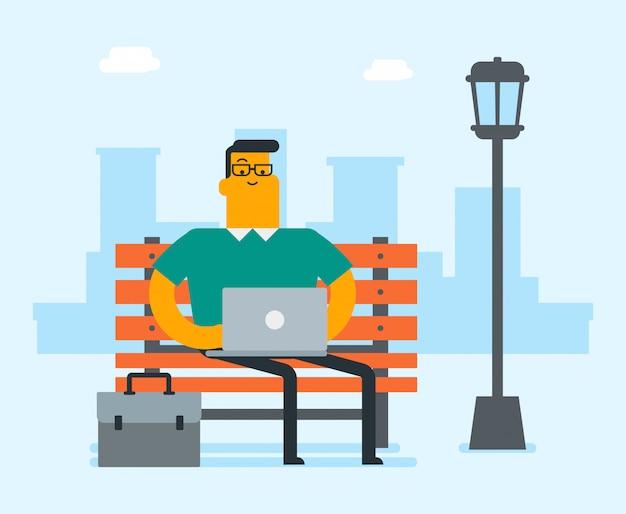 Homme d'affaires caucasien travaillant sur un ordinateur portable en plein air Vecteur Premium